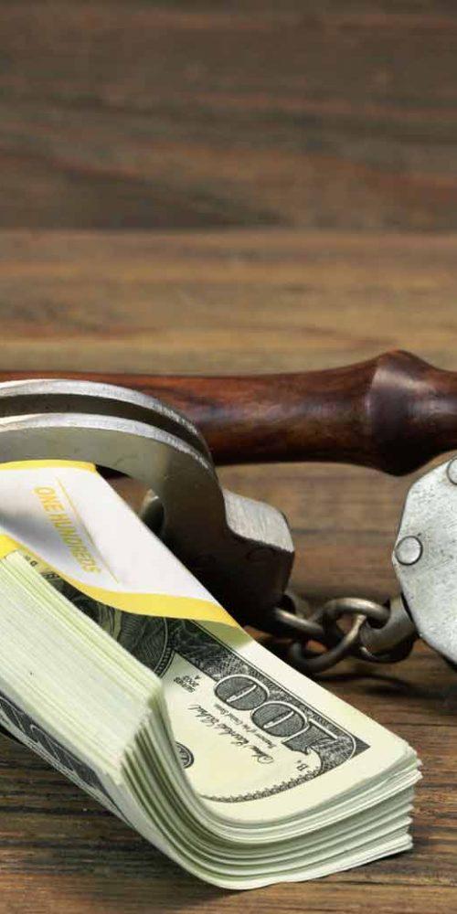 RedAnytimeBailBonds_handcuffs dollars gavel