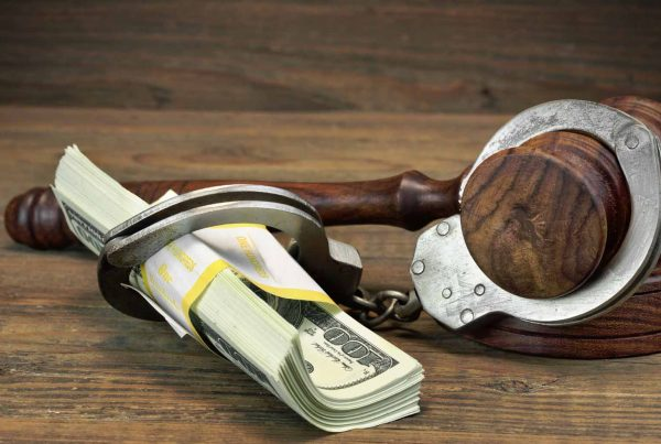RedAnytimeBailBonds_handcuffs dollars gavel