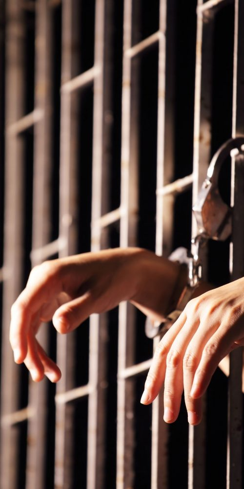 hands in jail locked with handcuff.